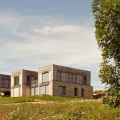 Eco-hameau de Bertignat: Lieux d'événements de style  par Boris Bouchet Architectes