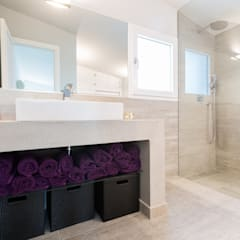 Baños de estilo  por ISLABAU constructora
