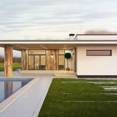 ПРОЕКТ ЧАСТНОГО ДОМА В ХАРЬКОВЕ «УЛИЦА 77»: Дома в . Автор – IK-architects, Минимализм Дерево Эффект древесины