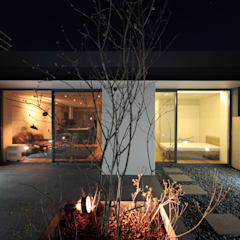 mom's house: 건축사사무소 moldproject의  베란다