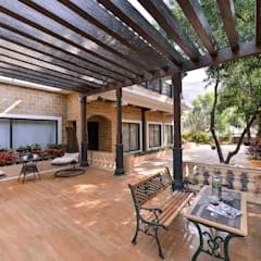Private Second-Home:  Terrace by ARK Reza Kabul Architects Pvt. Ltd.
