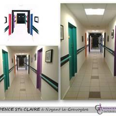 Le couloir des bureaux: Cliniques de style  par GC Aménagement Intérieur