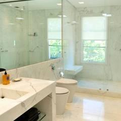 Casa Tortugas: Baños de estilo  por JUNOR ARQUITECTOS,Moderno
