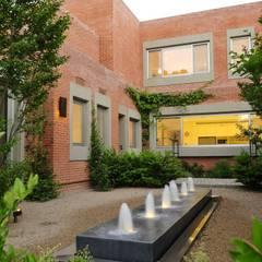 Casa en Mailyng: Jardines de estilo  por JUNOR ARQUITECTOS,Moderno