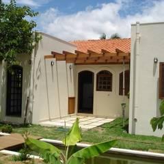 colonial Houses by Mina Arquitetura & Construções