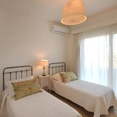 dormitorio 3: Dormitorios de estilo  por Parrado Arquitectura