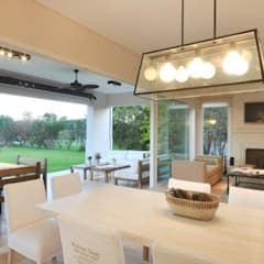 espacio integrado: Comedores de estilo  por Parrado Arquitectura