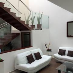 Sala: Salas de estilo  por Ambás Arquitectos