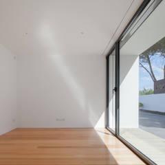 Dormitorios de estilo  por Raulino Silva Arquitecto Unip. Lda