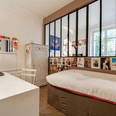 Paris 9: Chambre d'enfant de style  par blackStones