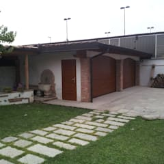 Galleria Realizzazioni: Garage/Rimessa in stile in stile Moderno di DOORHAN ITALIA SRL