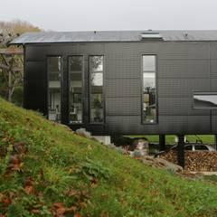 CARBONE WOOD: Maisons de style  par Bertin Bichet