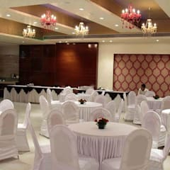 Banquet hall:  Exhibition centres by Ishita Joshi Designs - Love Living!