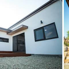 박공지붕의 모던 ALC 전원주택: (주)홈스토리의  주택