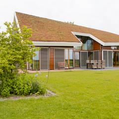 Vaste planten tuin in Houten: scandinavische Tuin door Mocking Hoveniers