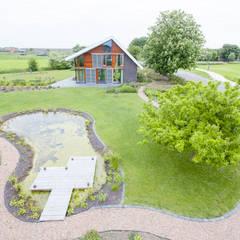 Vaste planten tuin in Houten:  Tuin door Mocking Hoveniers