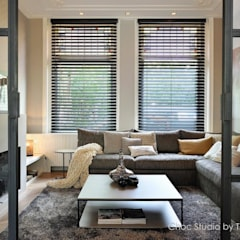 stadswoning met spicy details:  Woonkamer door choc studio interieur, Modern