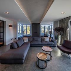 Living: moderne Woonkamer door Medie Interieurarchitectuur