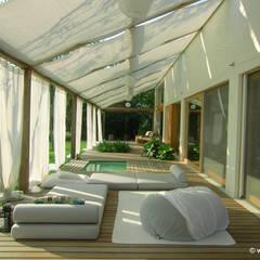 Terrazas de estilo  por Woodbau Srl, Clásico Madera Acabado en madera