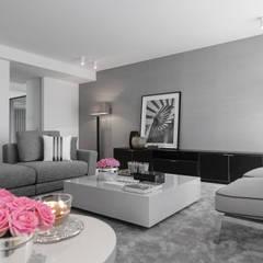 Casa em Braga: Salas de estar  por CASA MARQUES INTERIORES