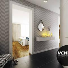Jasne kolory zestawione z nowoczesnymi wzorami nadającymi efektowny wygląd  holu.: styl , w kategorii Korytarz, przedpokój zaprojektowany przez MONOstudio