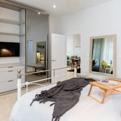Master bed by WN Interiors:  Bedroom by WN Interiors of Poole in Dorset