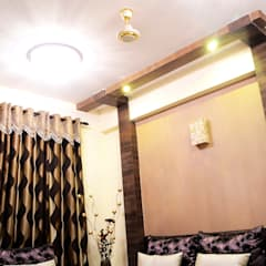 Arihant Ambience Apartment.:  Living room by Decor At Door