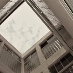 Edificio Metropolitano: Paredes de estilo  por Boquer 3, Ecléctico