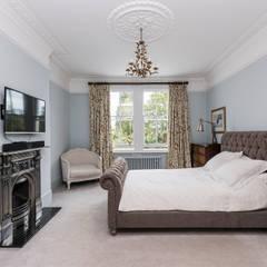 Full renovation on Trinity Road, London:  Bedroom by Grand Design London Ltd