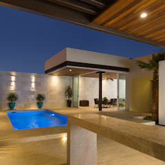 Ampliación Residencia La Rioja: Estudios y oficinas de estilo  por Grupo Arsciniest,
