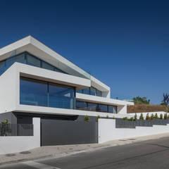 moderne Häuser von JPS Atelier - Arquitectura, Design e Engenharia