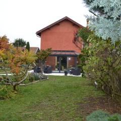 vue EST habitation principale: Terrasse de style  par KREA Koncept