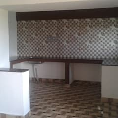Kitchen by NISHA MIDAS CONSTRUCTION,