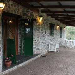 Galería: Terrazas de estilo  por Casas de Campo