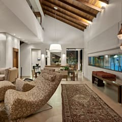 Residência AM: Salas de estar  por Isabela Canaan Arquitetos e Associados