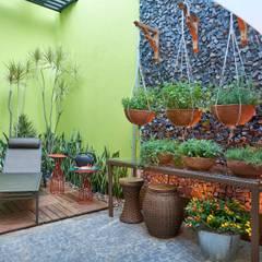Mostra de Ambientes de Sete Lagoas - Cozinha Gourmet e Área Livre de Lazer: Jardins  por Lider Interiores
