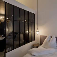 Schlafzimmer:  Schlafzimmer von LOSTINARCHITECTURE