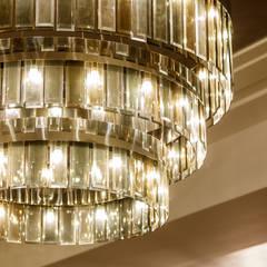 Bespoke lobby chandelier by Goddard Littlefair:  Commercial Spaces by Goddard Littlefair