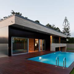 Casa AA_3: Casas  por XYZ Arquitectos Associados