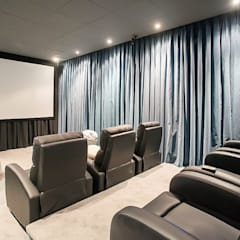 minimalistic Media room by ABAD Y COTONER, S.L.