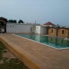 LAXMIWADI FARMHOUSE:  Pool by CREATORS
