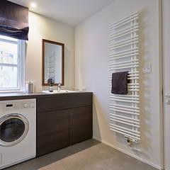 警固リノベ: 株式会社フーセット Huset co.,ltdが手掛けた浴室です。
