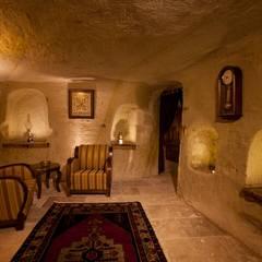 Kayakapi Premium Caves - Cappadocia – Emine Hanım evi Öncesi ve Sonrası: rustik tarz tarz Oturma Odası
