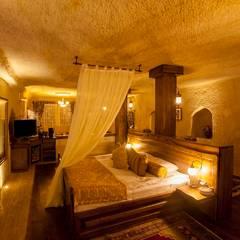 Kayakapi Premium Caves - Cappadocia – Kuşçular Konağı Öncesi Ve Sonrası:  tarz Yatak Odası