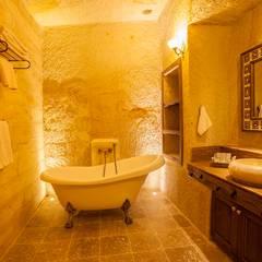 Kayakapi Premium Caves - Cappadocia – Kuşçular Konağı Öncesi Ve Sonrası: rustik tarz tarz Banyo