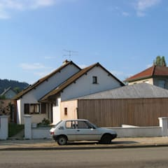 Façade sur rue: Garage / Hangar de style de style Moderne par Thierry Marco Architecture