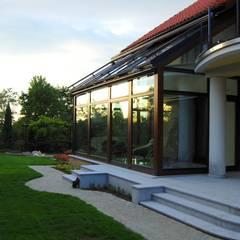 Jardines de invierno de estilo  por Pracownia Projektowa Architektury Krajobrazu Januszówka