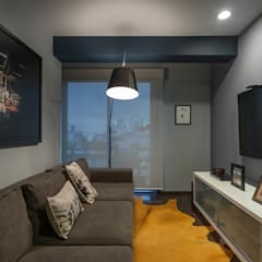 Media room by MAAD arquitectura y diseño, Eclectic