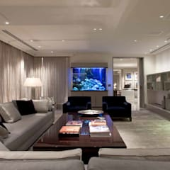Park Lane Penthouse:  Living room by Debbie Flevotomou Architects Ltd.