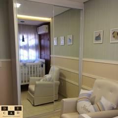 комнаты для новорожденных в . Автор – Duecad - Arquitetura e Interiores,